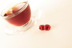 Tea cup and raspberry Royalty Free Stock Images