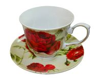 Tea cup with red flowers on white isolated background. The cup is on a saucer royalty free stock photos