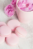 Tea cup with rose and pink macaroons Royalty Free Stock Images