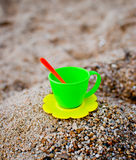 Tea cup upon the sand. Toy tea cup upon the sea sand close-up Stock Images