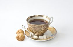 Tea cup on saucer. With sugar and baking Stock Photography