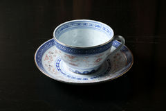 Tea cup saucer. Chinaware tea cup saucer old vintage on table Royalty Free Stock Images