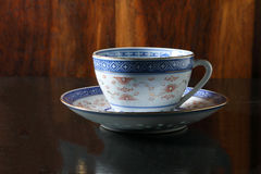 Tea cup saucer. Chinaware tea cup saucer old vintage on table Stock Images