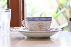 Tea cup saucer. Chinaware tea cup saucer old vintage on table Stock Image