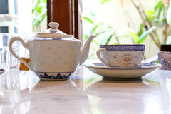 Tea cup saucer. Chinaware tea cup saucer old vintage on table Stock Photography