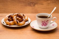 Tea Cup and saucer with donuts. Breakfast. Tea Cup and saucer with donuts. On wooden background Stock Image