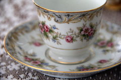 Tea cup and saucer on lace Royalty Free Stock Photography