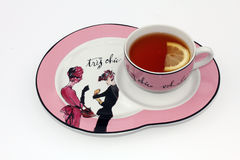 Tea cup and saucer with Lemon Stock Photos
