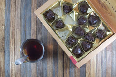 Tea Cup and set of chocolates Royalty Free Stock Image