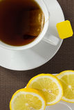 Tea cup and slice of lemon Stock Photos