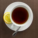 Tea cup and slice of lemon Stock Images