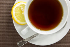 Tea cup and slice of lemon Stock Photography