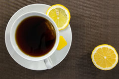 Tea cup and slice of lemon Stock Photo