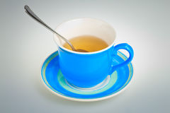 Tea cup with a spoon Stock Photography