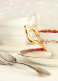Tea cup and spoon Royalty Free Stock Photos