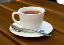 Tea, cup, spoon, wood, table Royalty Free Stock Photography