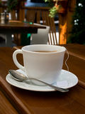 Tea, cup, spoon, wood, table Royalty Free Stock Image