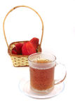 Tea cup and strawberry Stock Images