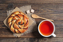 Tea cup and sweet bun Stock Image