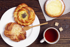 Tea cup and sweet buns Royalty Free Stock Images