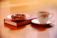 Tea cup with sweet cake and book Royalty Free Stock Images