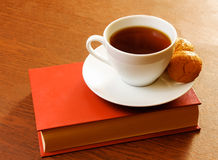 Tea cup with sweet cookie and book Stock Image