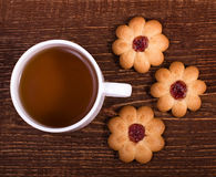 Tea cup with sweet cookie Stock Images