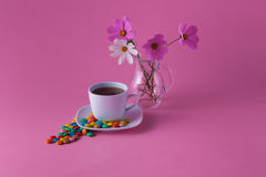 Tea cup with sweet dragees Royalty Free Stock Images