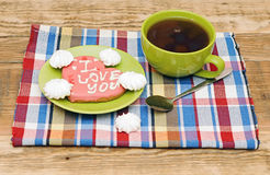 Tea cup with sweet heart shaped cookie Stock Photography