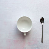 Tea cup on table. Spoon and cup on cement background and texture with space Stock Photography