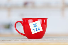 Tea Cup With Tag On Table Royalty Free Stock Image