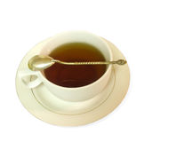Tea Cup with Tea. View of a tea cup with team and silver spoon Stock Photo