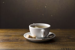 Tea cup with tea bag on saucer Royalty Free Stock Photo