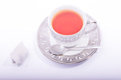 Tea cup with tea bag and spoon Royalty Free Stock Photos