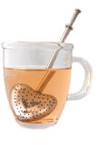 A tea cup with the tea infuser Royalty Free Stock Photos