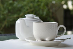Tea cup and tea pot Royalty Free Stock Images