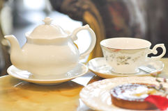 Tea cup and tea pot Royalty Free Stock Image