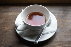 Tea cup and tea from upside on wood table Stock Images