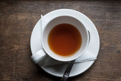 Tea cup and tea from upside on wood table Stock Image