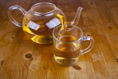 Tea cup with tea on wooden table Royalty Free Stock Image
