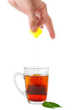 Tea cup and teabag Stock Images