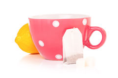 Tea cup with teabag and lemon Royalty Free Stock Photos