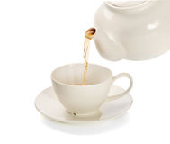 Tea cup and teapot Stock Images