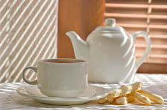 Tea cup with teapot Royalty Free Stock Photos