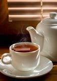 Tea cup with teapot Stock Photo