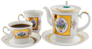Tea cup, teapot andcream-jug Stock Image