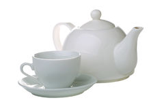 Tea cup with teapot isolated. On white royalty free stock image