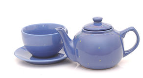 Tea cup with teapot Stock Images