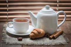 Tea cup with teapot on old wooden table Stock Photos