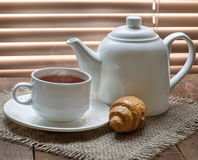 Tea cup with teapot on old wooden table Stock Photography